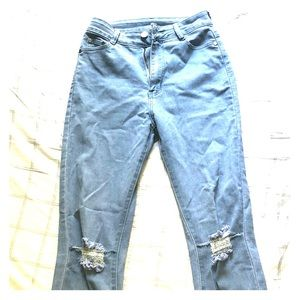 Distressed light blue jeans worn once